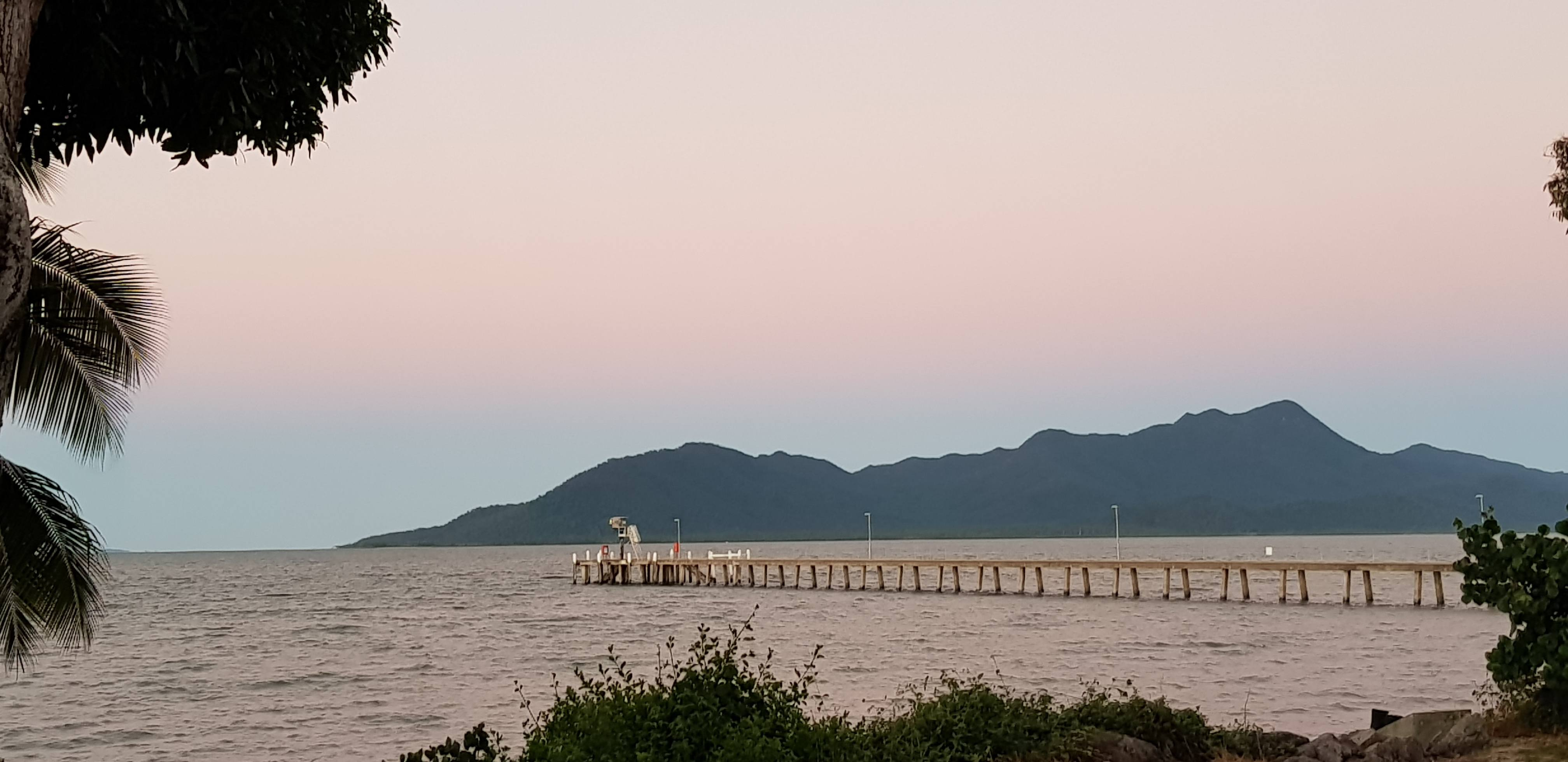 Cardwell Jetty at sunset with Hichinbrook Island in the background