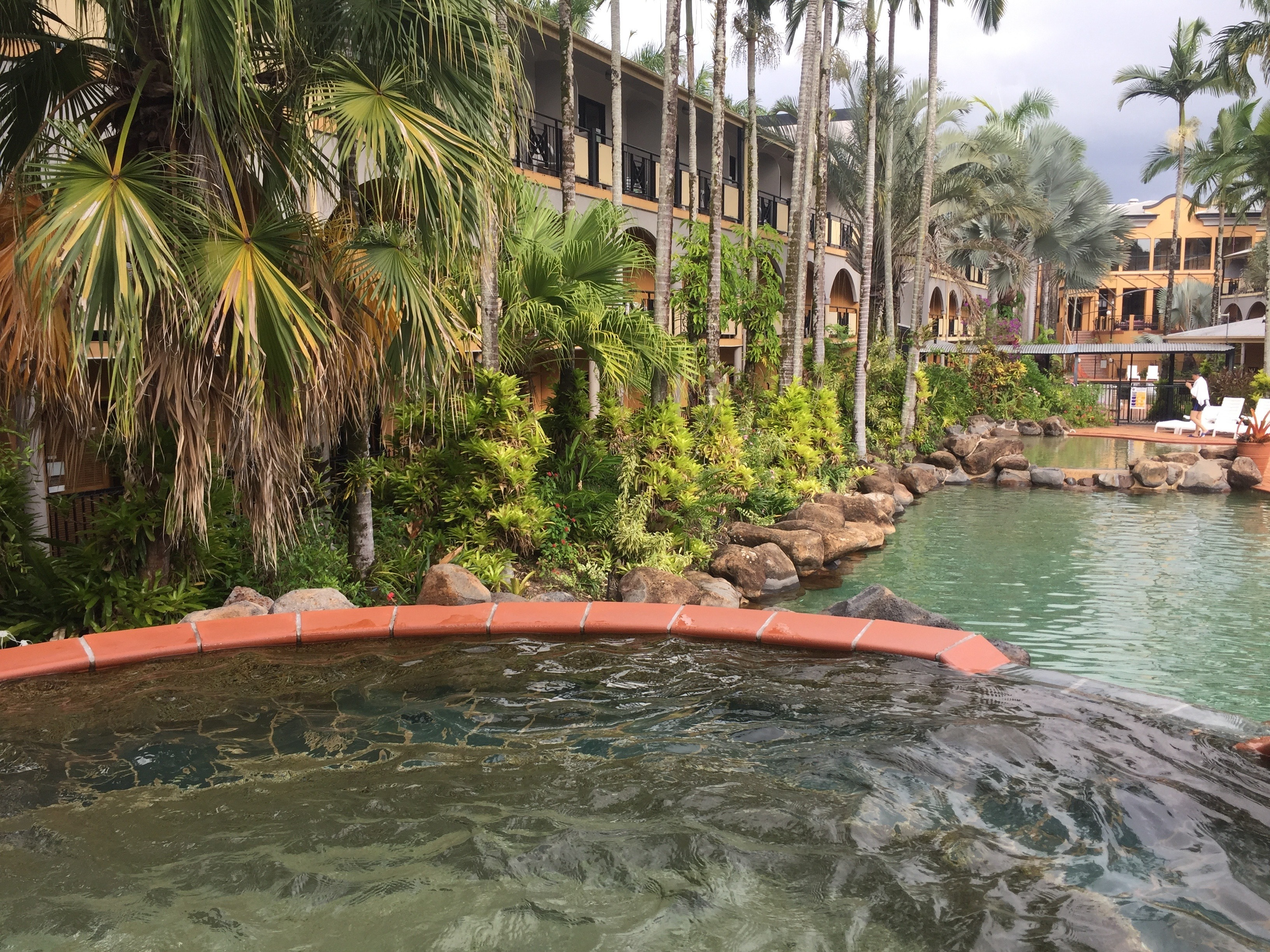 view from the spa, the pools & gardens - Palm Royale Cairns
